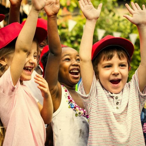 Group of kids school friends hand raised happiness smiling learn
